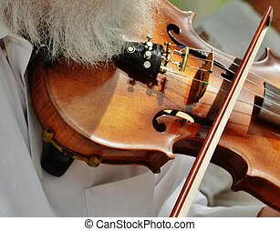 A musician playing the fiddle. - An accomplished musician...