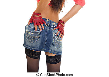 Close-up of sexy woman's buttocks in jeans skirt