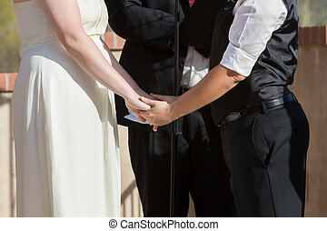 Women Holding Hands in Wedding Ceremony - Women holding...