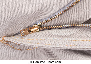 Zip on bright jeans close up