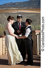 Rabbi with Gay Couple - Rabbi blessing lesbian marriage...