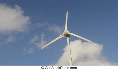 wind turbine with a blue cloudy sky background