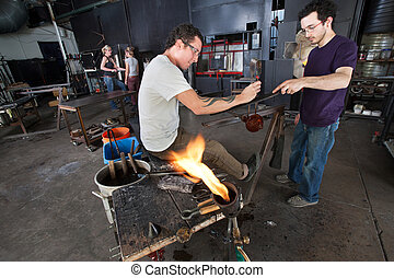 Glass Artists Working Together - Group of glass artists...