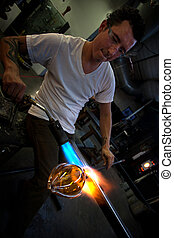 Man Forming Vase with Blowtorch - Man working at a glass...