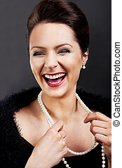 Fashion girl portrait with luxury accessories and big smile