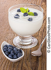 Fresh creamy natural yogurt with blueberries