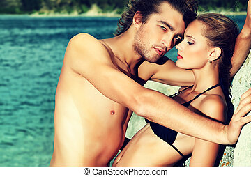 passionate couple - Beautiful young couple in love having...