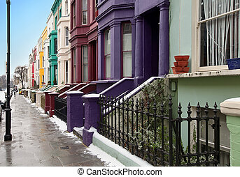 Winter street - London street with colorful houses during...