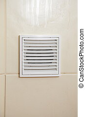 Vent white bathroom ventilation grille in tiled wall