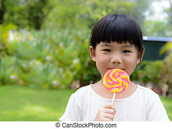 Kid with lollipop - Little girl eat lollipop with smiling...