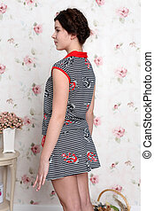 Young teenager girl in pajamas - view from the back