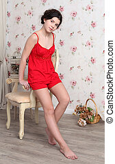 beautiful teenager girl in red pajamas