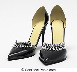 Black patent leather women's high heels closeup on a light...