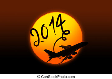 New year 2014 drawing by airplane on the sunset