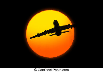 Beautiful sunset with airplane on black background