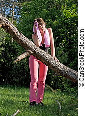 Feel tired - Young girl doing gymnastics in the nature with...