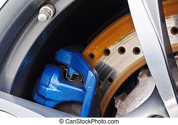 Disc Brakes - Detail close up of a motor vehicle or car disc...