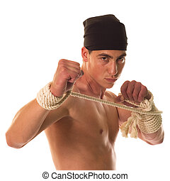 Boxer - Muscular builder man training with tied hands