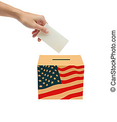 Hand putting a voting ballot into t