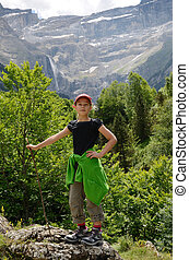 Youth hiker against the mountain cirque of Gavarnie - A girl...