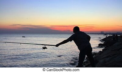 Fisherman throws the fishing tackle