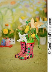 miracle boots - on a green background with flowers rubber...
