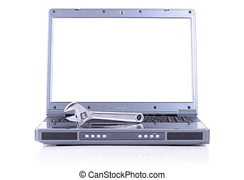 laptop it support - concept of it support with a spanner on...