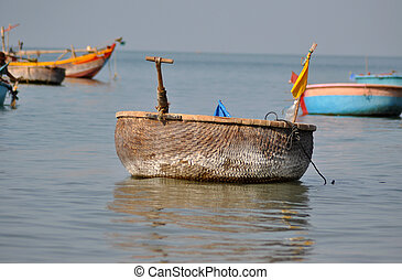 Traditional Vietnamese fishing boats in Mui Ne port, Vietnam