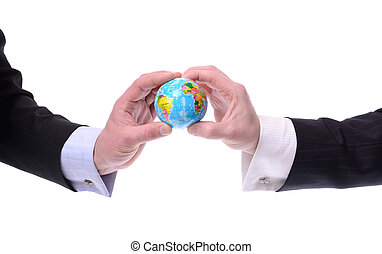 global communication - two businessmen holding a globe,...