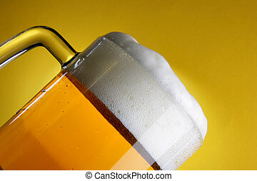 Beer mug with froth close-up