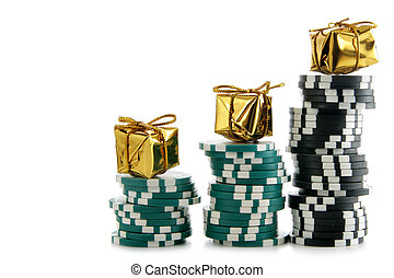 Casino chips with golden boxes - Stacks of casino chips with...