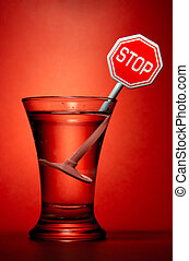Prohibition - Wineglass with stop sign over red background