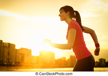 Woman running on summer sunset - Woman running and...
