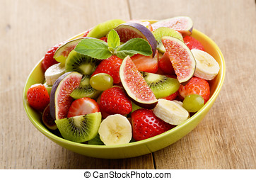 Fruit mix - Healthy fruit mix salad on the kitchen table
