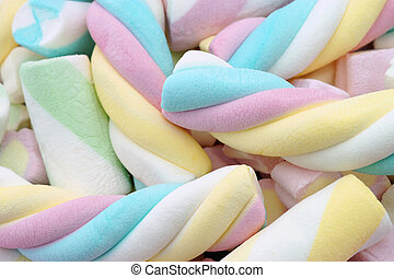 Marshmallow sweets in pink, blue, yellow and green soft...