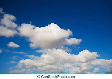 Puffy clouds - puffy white clouds over deep blue sky...