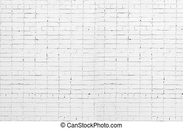A white roughly textured brick wall painted with white paint