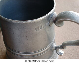 Antique Pewter Mug - An old mug made of pewter still looks...