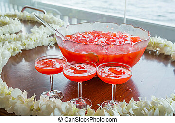 Fruit punch with ice served in beautiful big glass bowl