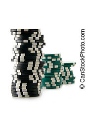 Casino chips - Three stacks of casino chips isolated over a...