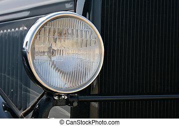 Headlight of black retro car close-up