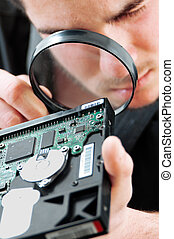 Computer service - Young electronics engineer making a...