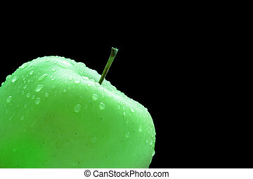 Granny smith apple isolated over a black background