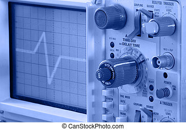 Oscilloscope close-up toning in blue color, focus on the...
