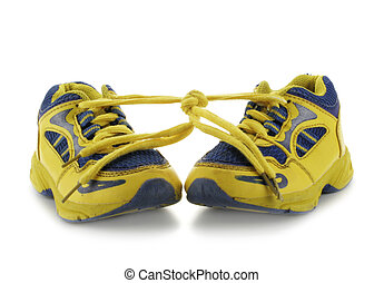 Child's running shoes - Child's yellow running shoes...