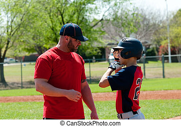 Baseball coach and teen player - Baseball coach giving...
