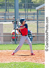 Teen baseball batter - Teen boy baseball player swinging...