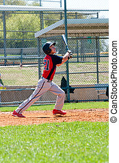 Teen baseball player at bat - Teen boy baseball player...