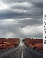 Desert empty road - A straight desert empty road under a...