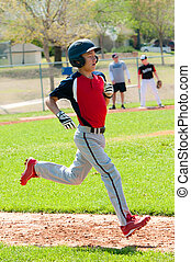 Teen baseball boy running to base.
